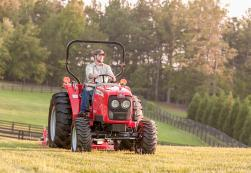 Massey Ferguson 1500 Series with a pull behind mower.