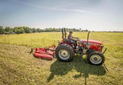 Massey Ferguson 2600H Series with a pull behind mower.