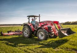 Massey Ferguson 5700 Series with front end loader and pull behind mower.