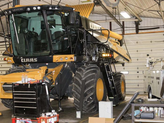 A Claas combine in the shop getting serviced.