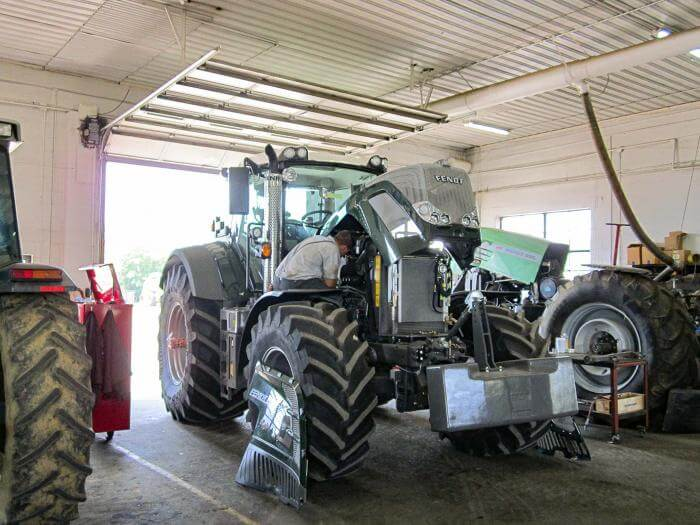 A Fendt tractor in the shop getting serviced.